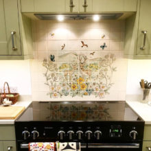 Hand painted Deer tile mural behind range cooker