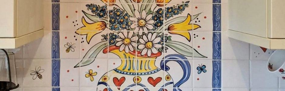 Hand painted flowers in jug tile mural