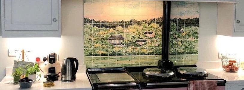 Green wood tile mural behind Aga range cooker in kitchen