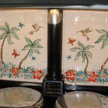 Hawaiian inspired kitchen tile mural behind aga range cooker