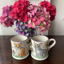 Pair of hand painted cat mugs