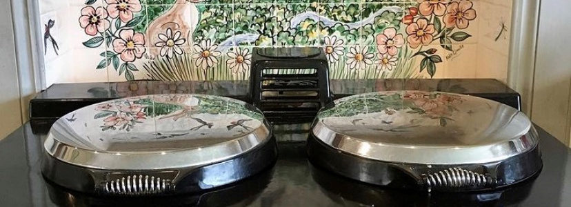 Swallows tile mural behind Aga range cooker