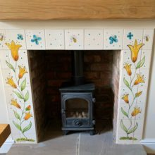 Fireplace with flower tile surround