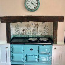 Kitchen tile mural behind Aga range cooker