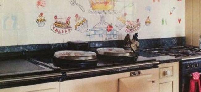 We love cakes tile mural behind Aga range cooker