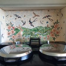 Bird tile mural behind Aga range cooker