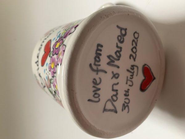 Hand painted personalised message on bottom of mug